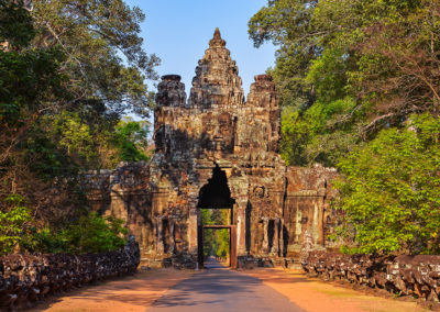 Entrance to ancient Angkor Wat temple at sunrise