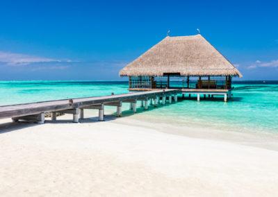 Wooden jetty on blue ocean in Maldives.